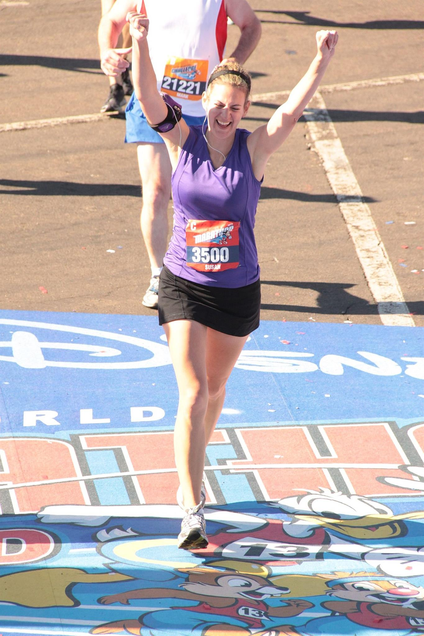 Susan rocked the finish line of the Walt Disney World Marathon. SUCH a great pic...you can taste her victory.