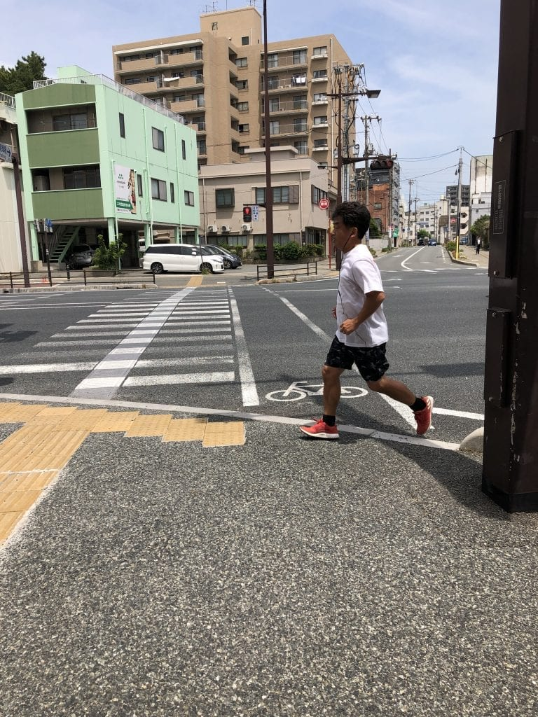 man running in a city